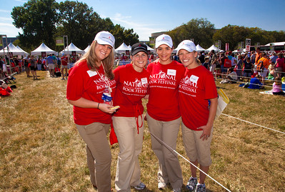 The Junior League of Washington (JLW) is made up of more than 2,200 highly trained volunteers dedicated to improving the community through effective action and leadership. In this photo, Tamara Webb, Meaghan Murry, Kristen Wilson and Morey Barnes Yost were among more than 450 JLW volunteers who joined the Library of Congress to promote literacy at the 10th annual National Book Festival on September 25, on the National Mall in Washington DC. (Photo by Jeff Malet).