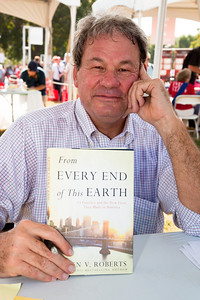 "Steven V. Roberts signs books at the National Book Festival. Roberts is the author of ""My Fathers' Houses"" and co-author of the New York Times best-seller ""From This Day Forward."" He has worked as a journalist for more than 40 years, including positions at U.S. News & World Report and The New York Times, where he was a bureau chief in Los Angeles and Athens and a correspondent for Congress and the White House. Roberts and his wife, television journalist and author Cokie Roberts, write a popular nationally syndicated newspaper column. A well-known commentator on many Washington-based television shows, Roberts appears regularly as a political analyst on the ABC radio network and National Public Radio. Since 1997 he has been the Shapiro Professor of Media and Public Affairs at George Washington University. His new book is ""From Every End of This Earth: 13 Families and the Lives They Made in America"" (HarperCollins). The 10th annual National Book Festival, organized and sponsored by the Library of Congress, was held on Saturday, Sept. 25, 2010, on the National Mall in Washington, D.C. (Photo by Jeff Malet)."