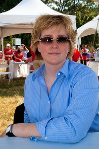 "Karin Slaughter signs books at the National Book Festival. International best-selling author Karin Slaughter has been writing novels and short stories since she was a child growing up in a small Georgia town. Her Grant County series consists of ""Blindsighted,"" ""Kisscut,"" ""A Faint Cold Fear,"" ""Indelible"" and ""Faithless."" Her newest book, ""Broken,"" (Random House) is the third to feature Special Agent Will Trent. Besides finding a home on The New York Times best-seller list, her books have been a Book Sense Top Mystery Pick and an International Book-of-the-Month Club selection. The 10th annual National Book Festival, organized and sponsored by the Library of Congress, was held on Saturday, Sept. 25, 2010, on the National Mall in Washington, D.C. (Photo by Jeff Malet)."