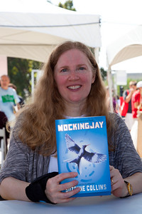 "Suzanne Collins signs books at the National Book Festival. Suzanne Collins has had a successful and prolific career writing for children's television. She has worked on the staffs of several Nickelodeon shows, including the Emmy-nominated hit ""Clarissa Explains It All"" and ""The Mystery Files of Shelby Woo."" Collins, who was named among Time magazine's 100 Most Influential People in 2010, made her mark in children's literature with the New York Times best-selling five-book series for middle-grade readers ""The Underland Chronicles,"" which has received numerous accolades in both the United States and abroad. In the award-winning ""The Hunger Games"" trilogy, Collins continues to explore the effects of war and violence on those coming of age. The final book in the trilogy, ""Mockingjay"" (Scholastic), was published in August and debuted at No. 1 on the USA Today best-seller list during its first week on sale and simultaneously appeared at No. 1 on the New York Times list. The 10th annual National Book Festival, organized and sponsored by the Library of Congress, was held on Saturday, Sept. 25, 2010, on the National Mall in Washington, D.C. (Photo by Jeff Malet)."