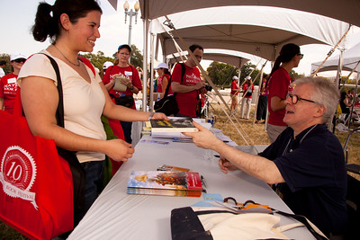 "Thomas Mallin signs a book at the National Book Festival for Abby Feld of the Cleveland Park section of Washington DC. Thomas Mallon received the Ingram Merrill Foundation Award in 1994 and won a Rockefeller Fellowship in 1987. His novels include ""Henry and Clara,"" ""Two Moons,"" ""Dewey Defeats Truman,"" ""Aurora 7"" and several works of nonfiction. He is a former literary editor of GQ and has contributed frequently to The New Yorker, The New York Times Magazine, The Atlantic Monthly and Harper's. He was appointed a member of the National Council on the Humanities in 2002 and served as deputy chairman of the organization. This year he became director of the creative writing program at George Washington University. His new book, ""Yours Ever: People and Their Letters"" (Pantheon) explores ""the offhand masterpieces dispatched through the ages by messenger, postal service and BlackBerry."" The 10th annual National Book Festival, organized and sponsored by the Library of Congress, was held on Saturday, Sept. 25, 2010, on the National Mall in Washington, D.C.  (Photo by Jeff Malet)."