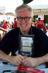 "Thomas Mallin signs books at the National Book Festival. Mallon received the Ingram Merrill Foundation Award in 1994 and won a Rockefeller Fellowship in 1987. His novels include ""Henry and Clara,"" ""Two Moons,"" ""Dewey Defeats Truman,"" ""Aurora 7"" and several works of nonfiction. He is a former literary editor of GQ and has contributed frequently to The New Yorker, The New York Times Magazine, The Atlantic Monthly and Harper's. He was appointed a member of the National Council on the Humanities in 2002 and served as deputy chairman of the organization. This year he became director of the creative writing program at George Washington University. His new book, ""Yours Ever: People and Their Letters"" (Pantheon) explores ""the offhand masterpieces dispatched through the ages by messenger, postal service and BlackBerry."" The 10th annual National Book Festival, organized and sponsored by the Library of Congress, was held on Saturday, Sept. 25, 2010, on the National Mall in Washington, D.C. (Photo by Jeff Malet)."