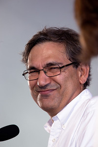 "Orhan Pamuk speaks at the National Book Festival. Pamuk was born in Istanbul and grew up in a large family similar to those that he describes in his novels ""Cevdet Bey and His Sons"" and ""The Black Book,"" in the city's wealthy westernized district. As he writes in his autobiographical ""Istanbul,"" from his childhood until the age of 22 he devoted himself largely to painting and dreamed of becoming an artist. After graduating from the secular American Robert College in Istanbul, he studied architecture at Istanbul Technical University for three years, but abandoned the course when he gave up his ambition to become an architect and artist. He went on to graduate in journalism from Istanbul University, but never worked as a journalist. At the age of 23, Pamuk decided to become a novelist and, giving up everything else, retreated into his flat and began to write. Pamuk's books have been translated into 58 languages; and eight of them have been translated from Turkish into English His new book is ""The Museum of Innocence"" (Knopf). In 2006 Pamuk was awarded the Nobel Prize in Literature. The 10th annual National Book Festival, organized and sponsored by the Library of Congress, was held on Saturday, Sept. 25, 2010, on the National Mall in Washington, D.C. (Photo by Jeff Malet)."