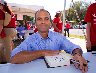 "Scott Turow signs books at the National Book Festival. Turow is a writer as well as an attorney. He is the author of eight novels including his first novel, 1987's ""Presumed Innocent,"" and its sequel, this year's ""Innocent"" (Grand Central Publishing). Turow's books have won a number of literary awards, and his books have been translated into more than 25 languages, sold more than 25 million copies worldwide and been adapted into a full-length film and two television miniseries. The 10th annual National Book Festival, organized and sponsored by the Library of Congress, was held on Saturday, Sept. 25, 2010, on the National Mall in Washington, D.C. (Photo by Jeff Malet)."