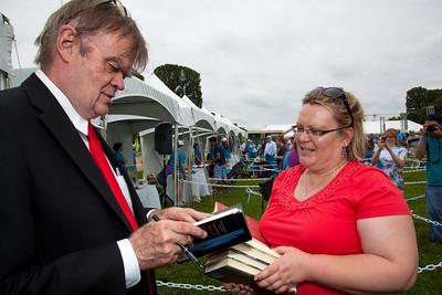 The Festival once again brought many of the nation's best authors, illustrators, and poets to Washington to discuss their work and meet their fans. Garrison Keillor signs books for Megan Barr of Alexandria VA.