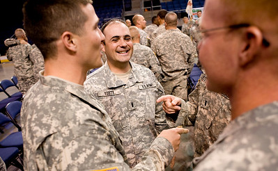 1st Lt. Timber Toste (center) chats with fellow compatriots John Avery (left) and Trinity Camper after National Guard homecoming ceremony at the 1st Bank Center in Broomfield, Thursday, April 1, 2010. The unit just returned from a tour in Iraq.