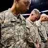 Platoon Sgt. J.W. Assad prays with the rest of the soldiers during the National Guard homecoming ceremony at the 1st Bank Center in Broomfield, Thursday, April 1, 2010. Assad just returned from a tour in Iraq.