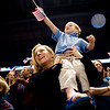 Stephanie Wilcox, of Colorado Springs, holds her, Jacob, 3, as they look for their husband and father during the National Guard homecoming ceremony at the 1st Bank Center in Broomfield, Thursday, April 1, 2010.