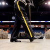 A member of the VFW National Honor Guard of Longmont carries out the flags during  National Guard homecoming ceremony at the 1st Bank Center in Broomfield, Thursday, April 1, 2010.
