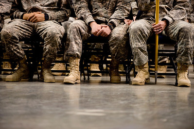Soldiers listen to a speech by Governor Bill Ritter during the National Guard homecoming ceremony at the 1st Bank Center in Broomfield, Thursday, April 1, 2010. The Third Battalion 157 Field Artillery just returned from a tour in Iraq.