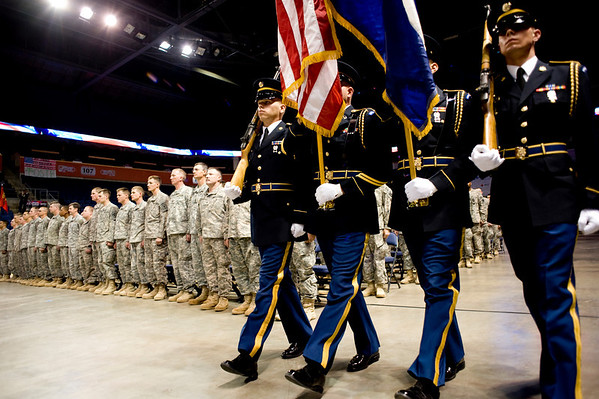 Members of the National Guard carry in the flags for the National Guard homecoming ceremony at the 1st Bank Center in Broomfield, Thursday, April 1, 2010. The soldiers just returned from a tour in Iraq.