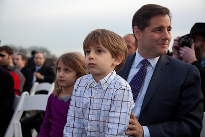 """Julius Genachowski, the chairman of the Federal Communications Commission with his children Lilah and Aaron attend a special lighting ceremony for the National Hanukkah Menorah, on the Ellipse, just across from the White House on the first night of the eight-day Jewish holiday. The first candle was lit on Tuesday, December 20, 2011 by special guest, Office of Management and Budget Director Jacob Lew. """"The President's Own"""" U.S. Marine Band, and """"The Three Cantors"""" performed. The national menorah lighting dates to 1979 when Jimmy Carter was president. Hanukkah celebrates the Jewish Maccabees' military victory over Syrian oppression more than two-thousand years ago. A candle is lit each night of the eight-day celebration, commemorating the miracle of one day's supply of oil lasting a full eight days in the lamp following the rededication of the Holy Temple in Jerusalem. This annual event is sponsored by American Friends of Lubavitch (Chabad). (Photo by Jeff Malet)"""