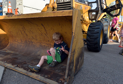 Rylan Ball, 6, plays in the front loader of a tractor during the National Night Out Picnic in the Park at Broomfield County Commons Park on Tuesday.  August 7, 2012 staff photo/ David R. Jennings