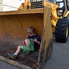 Rylan Ball, 6, plays in the front loader of a tractor during the National Night Out Picnic in the Park at Broomfield County Commons Park on Tuesday.<br /> <br /> August 7, 2012<br /> staff photo/ David R. Jennings