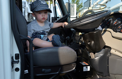 Vonn Snapp, 1, sits on the right hand seat of a street sweeper during the National Night Out Picnic in the Park at Broomfield County Commons Park on Tuesday.  August 7, 2012 staff photo/ David R. Jennings