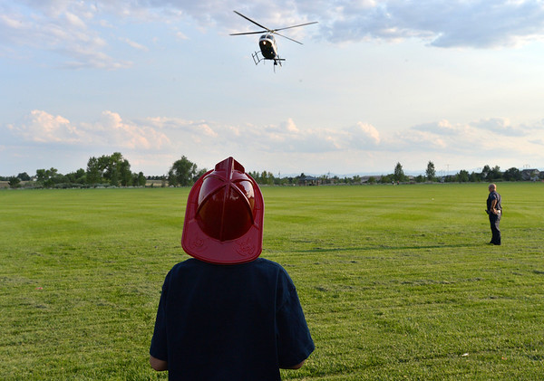 Jordan Bransom, 8, watches an Air Life medical helicopter land  during the National Night Out Picnic in the Park at Broomfield County Commons Park on Tuesday.<br /> <br /> August 7, 2012<br /> staff photo/ David R. Jennings