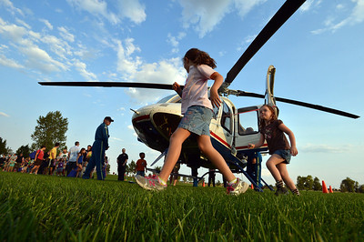 Reagan Petitt, 7, and her sister Camryn, 4, run around the front of the Air Life medical helicopter during the National Night Out Picnic in the Park at Broomfield County Commons Park on Tuesday.  August 7, 2012 staff photo/ David R. Jennings