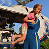 Cecilia Guerrera, 5, is helped out of the AirLife helicopter by EMT-B  Taylor Mustachio, right, during the National Night Out Picnic in the Park at Broomfield County Commons Park on Tuesday.<br /> <br /> <br /> August 7, 2012<br /> staff photo/ David R. Jennings