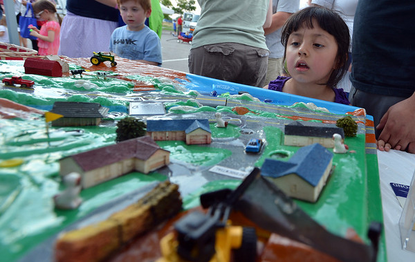 Malerie Jacquez, 4, watches the demonstration of how polluted water can effect the water supply during the National Night Out Picnic in the Park at Broomfield County Commons Park on Tuesday.<br /> <br /> August 7, 2012<br /> staff photo/ David R. Jennings