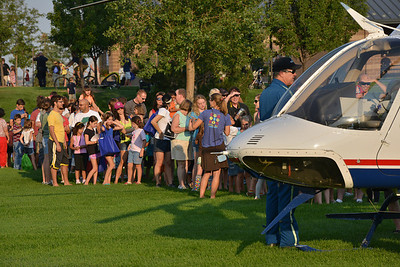 People line up to look at the Air Life helicopter during the National Night Out Picnic in the Park at Broomfield County Commons Park on Tuesday.  August 7, 2012 staff photo/ David R. Jennings