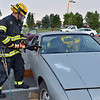 North Metro Fire Rescue firefighter Paul Strongwater begins to take off the roof of a car for an extrication demonstration during the National Night Out Picnic in the Park at Broomfield County Commons Park on Tuesday.<br /> <br /> August 7, 2012<br /> staff photo/ David R. Jennings