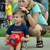 Kelly O'Keefe points out to her son Conor Martau, 5, what North Metro Fire Rescue firefighters are doing during an automobile extrication at the National Night Out Picnic in the Park at Broomfield County Commons Park on Tuesday.<br /> <br /> August 7, 2012<br /> staff photo/ David R. Jennings