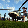 Reagan Petitt, 7, and her sister Camryn, 4, run around the front of the Air Life medical helicopter during the National Night Out Picnic in the Park at Broomfield County Commons Park on Tuesday.<br /> <br /> August 7, 2012<br /> staff photo/ David R. Jennings