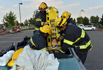 North Metro Fire Rescue District's Pam Kutchen plays the victim for firefighters for an extrication demonstration during the National Night Out Picnic in the Park at Broomfield County Commons Park on Tuesday.  August 7, 2012 staff photo/ David R. Jennings