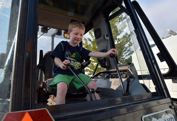 Rylan Ball, 6, plays with the controls of a backhoe during the National Night Out Picnic in the Park at Broomfield County Commons Park on Tuesday.<br /> <br /> August 7, 2012<br /> staff photo/ David R. Jennings