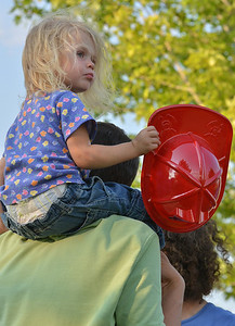 Phoebe Belanger, 2, sitting on her father, Derrick's shoulders while watching the Air Life helicopter land during the National Night Out Picnic in the Park at Broomfield County Commons Park on Tuesday.  August 7, 2012 staff photo/ David R. Jennings