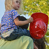 Phoebe Belanger, 2, sitting on her father, Derrick's shoulders while watching the Air Life helicopter land during the National Night Out Picnic in the Park at Broomfield County Commons Park on Tuesday.<br /> <br /> August 7, 2012<br /> staff photo/ David R. Jennings