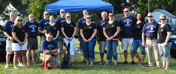 Diane Raver | The Herald-Tribune<br /> Batesville Police officers and their wives helped at the event.