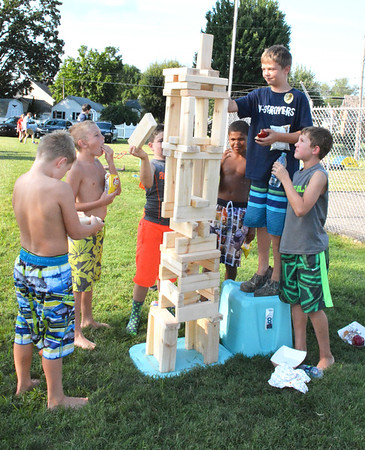 Diane Raver | The Herald-Tribune<br /> Will Jaisle (from left), Nathan Schornick, Jonathon Buschle, Christopher Tillman, Carter Bohman and Gus Prickel enjoyed the challenge of the giant Jenga game.