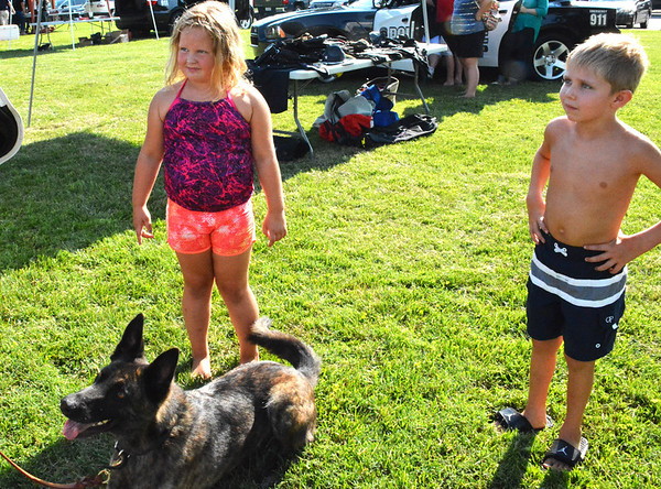 Diane Raver | The Herald-Tribune<br /> Drew Jaisle, 6, and Molly Abel, 7, listen carefully as Sgt. Danny Hamilton (not pictured) explains what K-9 Jinx can do.