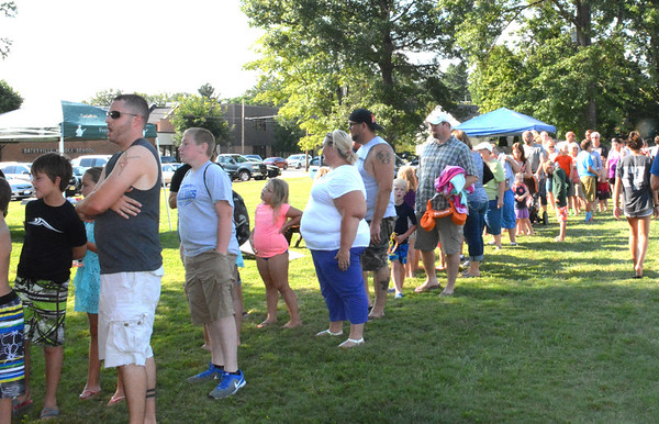 Diane Raver | The Herald-Tribune<br /> A large crowd waited in line to get some food.