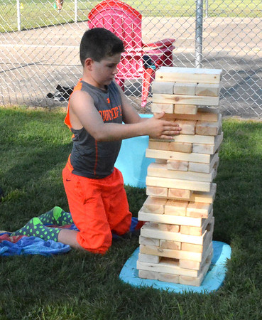 Diane Raver | The Herald-Tribune<br /> Jonathon Buschle concentrates on his next move in Jenga.