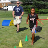 Diane Raver | The Herald-Tribune<br /> Batesville Police Patrolman Travis Cook (left) cheers on Christopher Tillman as he runs through the obstacle course.