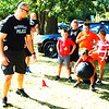 Diane Raver | The Herald-Tribune<br /> Batesville Patrolman Travis Cook gets kids ready for the obstacle course.