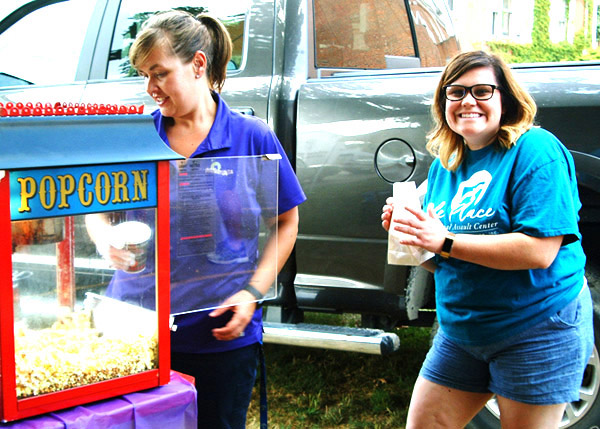 Debbie Blank | The Herald-Tribune<br /> Free popcorn was provided in Oldenburg by Sara Mustaine (left), Safe Passage nonresidential case manager for Franklin and Ripley counties, and Danielle Becker, Safe Place sexual assault advocate and prevention specialist. Safe Place is a division of the Batesville-based Safe Passage domestic violence facility.