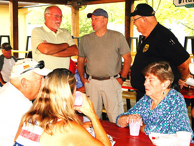 Debbie Blank | The Herald-Tribune Oldenburg Town Council President Dennis Moeller (from left), Franklin County Sheriff Peter Cates and Oldenburg Marshal Bill Dramann chat while other attendees eat the free supper.