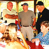 Debbie Blank | The Herald-Tribune<br /> Oldenburg Town Council President Dennis Moeller (from left), Franklin County Sheriff Peter Cates and Oldenburg Marshal Bill Dramann chat while other attendees eat the free supper.