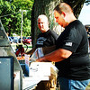 Diane Raver | The Herald-Tribune<br /> Batesville Police Chief Stan Holt (left) and Cpl. Ryan Metcalf grill hot dogs and hamburgers.