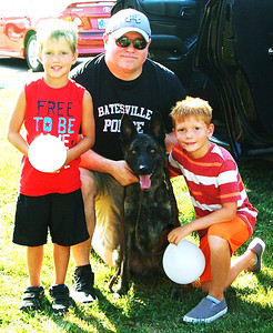 Diane Raver | The Herald-Tribune Lane Moody (left), 6, and Caden Lehman, 8, were excited to get their picture taken with Lt. Danny Hamilton and K-9 Jinx.