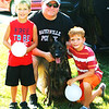 Diane Raver | The Herald-Tribune<br /> Lane Moody (left), 6, and Caden Lehman, 8, were excited to get their picture taken with Lt. Danny Hamilton and K-9 Jinx.