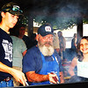 Debbie Blank | The Herald-Tribune<br /> Charlotte Trossman (from right), 11, Oldenburg, watches as grandpa Eddie Obermeyer, a Knights of St. John volunteer, and Austin Lovins, 17, Brookville, son of Franklin County Sheriff's Department Deputy Sgt. Jason Lovins, keep an eye on hamburgers and cheeseburgers on the grill at the Oldenburg shelterhouse.