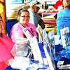 Debbie Blank | The Herald-Tribune<br /> At the Oldenburg event, Southeastern Indiana Economic Opportunity Corp. family development specialist Amber Moody (left) and Head Start family service worker Jennifer Mueller were passing out brochures about programs that can help individuals in need of assistance as well as low-income families. They also were giving away a motorized vehicle toy.