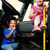 Debbie Blank | The Herald-Tribune<br /> Griffin Dunn (left), 3, Batesville, and sister Dyllan, 4, imagine what it would be like to be firetruck drivers inside an Eagle Fire Co. vehicle.