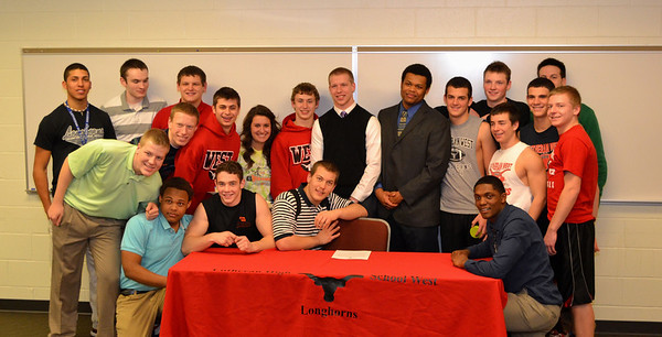 National Signing Day 2013. Lutheran West seniors, Chris Ranc and Kameron Bremer are joined by their class mates and team mates on National Signing Day 2013 as they signed with Ashland University and Notre Dame College respectively.  Photo courtesy of Ryan Kaczmarski of WestLife
