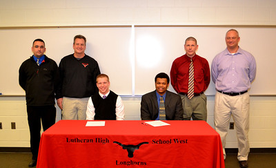 Lutheran West football coaches join Chris Ranc (Ashland University) and Kameron Bremer (Notre Dame College) on National Signing Day 2013.  Photo courtesy of Ryan Kaczmarski of WestLife.
