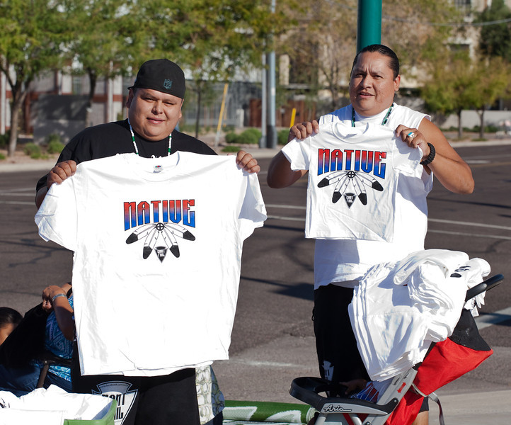 Rudy (right) made the shirts for this event.